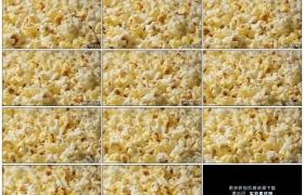 高清实拍视频素材丨特写旋转的金黄色爆米花
