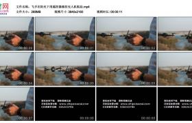 4K实拍视频素材丨飞手在阳光下用遥控器操控无人机航拍