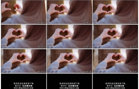 4K实拍视频素材丨特写女子用双手在树干上比出心形图案
