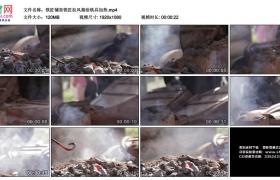 高清实拍视频素材丨铁匠铺里铁匠拉风箱给铁具加热