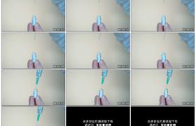 4K实拍视频素材丨特写医生将玻璃药品中的药液吸到注射器中