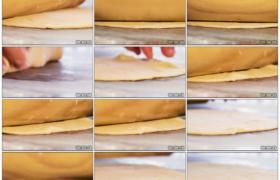 4K实拍视频素材丨特写用擀面杖将面皮压薄