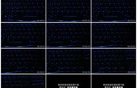 高清实拍视频素材丨摇摄亮着蓝色灯光的电脑键盘