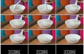 4K实拍视频素材丨特写用勺子吃碗里的汤圆