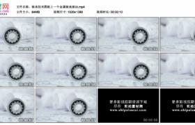 高清实拍视频素材丨轴承技术图纸上一个金属轴承滚动