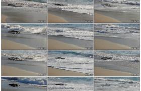 高清实拍视频素材丨海水泛着波浪席卷沙滩