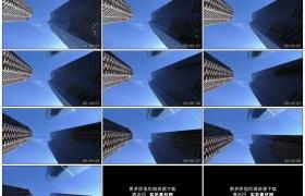 4K实拍视频素材丨仰拍晴天蓝天下高耸的商务楼