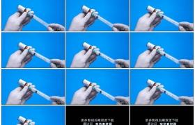 4K实拍视频素材丨医生拿着一支注射器抽取药瓶中的新冠病毒疫苗