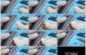 4K实拍视频素材丨特写维修人员将手机sim卡插进手机卡槽