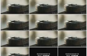高清实拍视频素材丨特写金属烟灰缸上放着的香烟燃烧