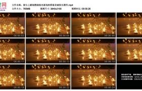 4K实拍视频素材丨窗台上蜡烛燃烧烛光摇曳映照着圣诞快乐摆件