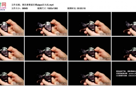 高清实拍视频丨黑色背景前打燃zippo打火机