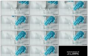 高清实拍视频素材丨特写医生用注射器抽取药瓶中的药液