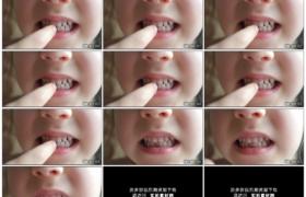 4K实拍视频素材丨特写小女孩用手指着自己掉落的门牙